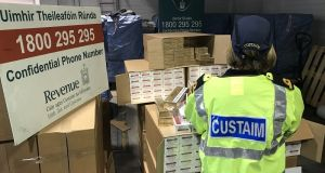 A customs officer seen with the shipment discovered on Wednesday. Photograph: Revenue