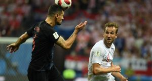 Harry Kane watches Dejan Lovren clear his lines with a header. Photograph: Getty Images
