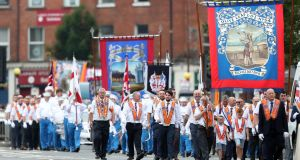Bandsmen and Orange order members take part in the annual Twelfth of July celebrations in Belfast city centre on Thursday. Photograph: Niall Carson/PA Wire