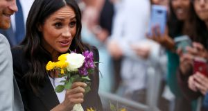 Meghan Markle  greeting spectators as they arrive for a visit at Trinity College in Dublin. Photograph: Trinity College handout