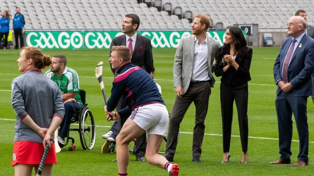 Prince Harr and Meghan Markle watch Galway's Joe Canning give an exhibition of hurling at Croke Park. Photograph: Morgan Treacy/Inpho