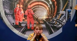 Aaron Doyle (8) was among Glasnevin Na Fianna members who visited en mass the public information session hosted by Transport Infrastructure Ireland about the proposed Metrolink project. Photograph: Nick Bradshaw