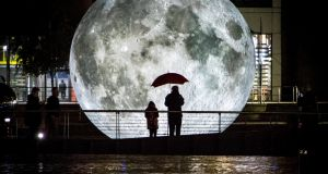 The festival's street art and spectacle includes Museum of the Moon, a giant moon featuring detailed Nasa imagery of the lunar surface by artist Luke Jerram, at NUI Galway's Human Biology Building. Photograph: Carl Milner Photography