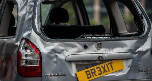 "A banged up car decorated with a banner saying ""For sale - but no one's buying May's Brexit banger"" is driven around Parliament Square. The People's Vote Campaign organised the stunt. Photograph: Getty Images"