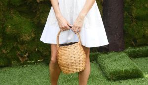 Actress Sienna Miller attends the 11th annual Veuve Clicquot Polo Classic at Liberty State Park with her straw bag. Photograph:   Jamie McCarthy/Getty Images for Veuve Clicquot