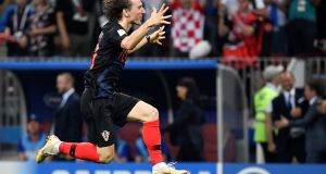 'The diminutive Luka Modric from Zadar shows that combination of talent and grit that defines great players.' Photograph: Alexander Nemenov/AFP.