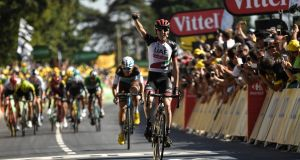 Ireland's Dan Martin celebrates as he crosses the finish line to win the sixth stage of the 105th edition of the Tour de France between Brest and Mur-de-Bretagne Guerledan, western France. Photo: Marco Bertorell/Getty Images