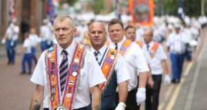 Bandsmen and Orange order members take part in the annual Twelfth of July celebrations in Belfast city centre. Photograph: Niall Carson/PA Wire