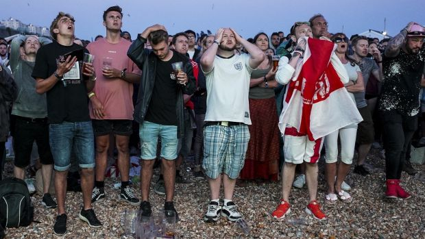 England fans react to Croatia's winning goal on Brighton Beach. Photo: Alan Crowhurst/Getty Images
