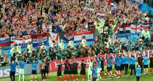 Croatia players salute their fans as they celebrate after their World Cup semi-final win over England in Moscow. Photo: Damir Sagolj/Reuters