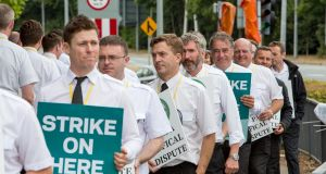 Ryanair pilots, who are members of the Irish Airline Pilots' Association, on picket duty at Dublin Airport on Thursday.  Photograph: Conor Healy