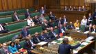 Labour former minister Ben Bradshaw (bottom right) throws copies of the Brexit White Paper to colleagues as Brexit secretary Dominic Raab makes a statement to MPs in the House of Commons. Photograph: PA Wire