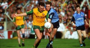 Anthony Molloy of Donegal is tackled by Dublin's Paul Bealin  in  the 1992   All-Ireland  final. Photograph: Inpho