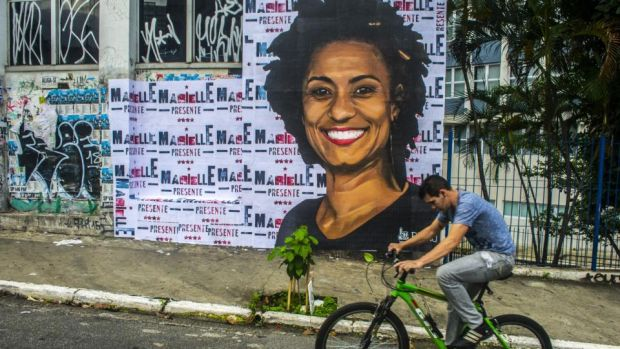 Assassination: after years in the shadows Brazil's militias are now back in the spotlight after the death of Marielle Franco, a black Rio city councillor, and her driver, Anderson Gomes. Photograph: Cris Faga/NurPhoto via Getty