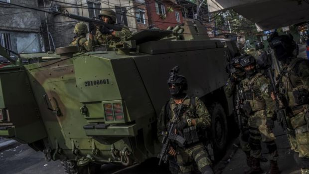 Gang war: soldiers patrol a favela in Rio that has been taken over by drug gangs. Photograph: Dado Galdieri/New York Times