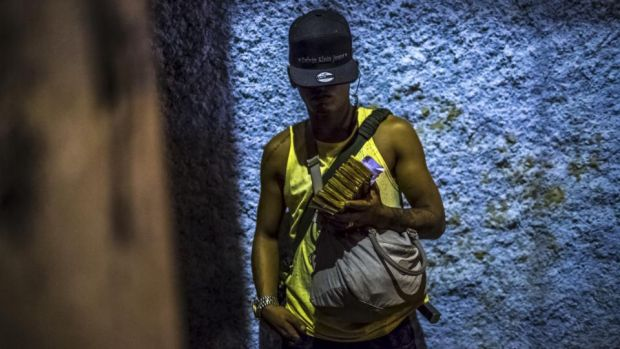 Militia target: a soldier in one of Rio de Janeiro's drug gangs, which paramilitary groups have been trying to drive out. Photograph: Dado Galdieri/New York Times