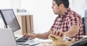 Dining at your desk is bad for your health and your waistline. Photograph: iStock