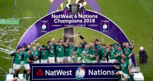 Ireland celebrate after securing the Grand Slam at Twickenham. Photograph: James Crombie/Inpho