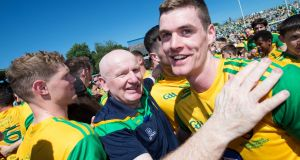 Donegal manager Declan Bonner celebrates with Caolan Ward after beating Fermanagh last month in the senior football championship at St Tiernach's Park, Clones. Photograph: Tommy Dickson/Inpho