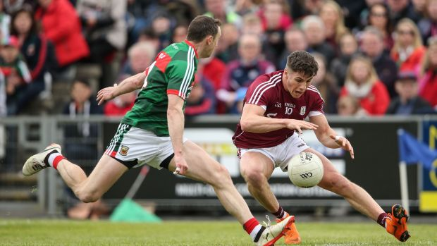 Galway's Shane Walsh is challenged by Mayo's Keith Higgins during the Connacht SFC quarter-final at Elvery's McHale Park in Castlebar. Photograph: Cathal Noonan/Inpho