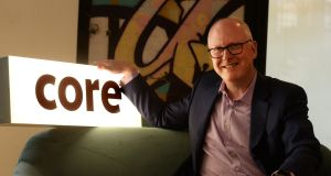 Alan Cox, chief executive of Core, at its new premises at Windmill Lane, where the reception contains part of the wall made famous by U2 fans. Photograph: Cyril Byrne