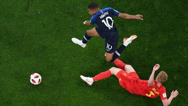 Kylian Mbappé gets beyond Belgium's Kevin De Bruyne in the World Cup semi-final. Photograph: Jewel Samad/AFP/Getty Images