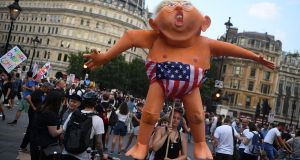 Protesters take part in a demonstration against US president Donald Trump's visit to the UK, in Trafalgar Square. Photograph: Chris J Ratcliffe/Getty Images