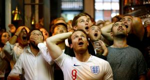 England fans watch Croatia v England in Trafalgar Square, London. Photograph: Henry Nicholls/Reuters