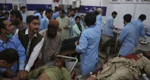 Hospital staff treat people injured in a bomb blast, at a hospital in Quetta, Pakistan. Photograph: Arshad Butt/AP