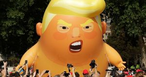 A cartoon baby blimp of US president Donald Trump in Parliament Square, London. Photograph: Matt Dunham/AP