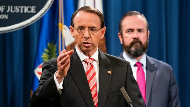 US deputy attorney general Rod Rosenstein announces that the Justice Department is indicting 12 Russian military officers for hacking Democratic emails. Photograph: Jim Lo Scalzo/EPA