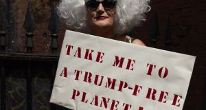 A drag queen joins protesters against the UK visit of US president Donald Trump as they gathered to take part in a march and rally in London on Friday. Photograph:  Niklas Hallen/AFP/Getty Images