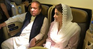 Former prime minister Nawaz Sharif and his daughter Maryam Nawaz await arrest on an aircraft after their arrival in Lahore. Photograph: PML-N/Getty Images