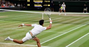 Novak Djokovic in action during his semi-final match against  Rafael Nadal at Wimbledon. Photograph: Toby Melville/Reuters