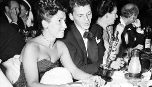 Nancy Sinatra with Frank Sinatra in March 1964 as he looks at the Oscar he won for his performance role in  The House I Live In. Photograph: AP