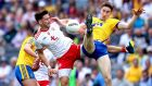 Tyrone's Pádraig Hampsey and Cathal Compton of Roscommon battle for possession during the the All-Ireland SFCquarter-final Super 8 game at Croke Park. Photograph: James Crombie/Inpho