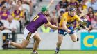 Clare's Tony Kelly is challenged by Aidan Nolan of Wexford. Photograph: Tommy Dickson/Inpho