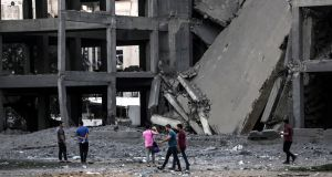 Palestinians inspect a building allegedly damaged by Israeli air strikes, at central Gaza City. Photograph: Haitham Imad/EPA