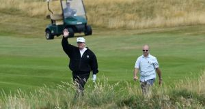 US President Donald Trump gestures as he plays a round of golf on the Ailsa course at Trump Turnberry. Photograph: AFP/Getty Images