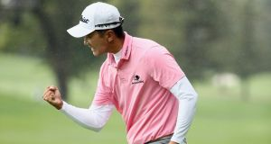 Michael Kim leads by five strokes in the John Deere Classic. Photograph: Ezra Shaw/Getty