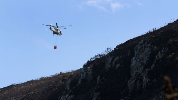 An Air Corps helicopter assists firefighters on Bray Head. Photograph: Nick Bradshaw for The Irish Times