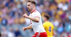 Tyrone's Niall Sludden celebrates scoring his side's opening goal against Roscommon at Croke Park. Photograph: James Crombie/Inpho