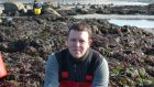 Dr Liam Morrison of NUI Galway, who has led a new study on the impact on human health of arsenic in seaweed used for animal feed, collecting samples of Ascophyllum Nodosum seaweed on the shoreline.