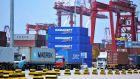 Containers being transferred at a port in Qingdao in China's eastern Shandong province. With China and the EU facing into trade wars with the US, both sides see the meeting as important in cementing an alliance in defence of the World Trade Organisation. Photograph: AFP/Getty Images