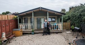Marc Carroll  and Sharon Brerton outside their log cabin   in Raheny,  Dublin. Photograph:James Forde
