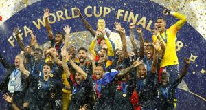Hugo Lloris lifts the trophy as France celebrate after winning the World Cup  REUTERS/Kai Pfaffenbach