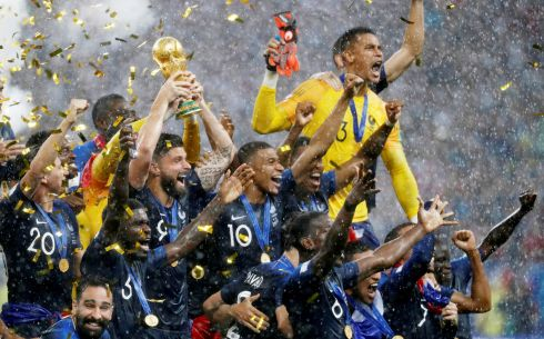 France's Olivier Giroud lifts the trophy as they celebrate winning the World Cup  REUTERS/Damir Sagolj