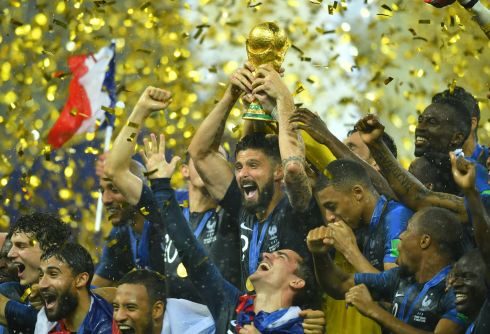 Olivier Giroud lifts the trophy as they celebrate winning the World Cup  REUTERS/Dylan Martinez