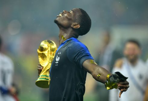 France's Paul Pogba holds the trophy as he celebrates winning the World Cup  REUTERS/Dylan Martinez