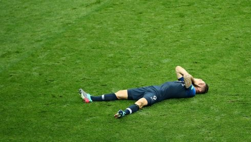 France's Olivier Giroud celebrates winning the World Cup  REUTERS/Michael Dalder